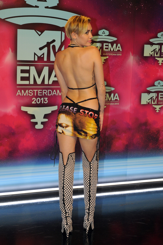US singer and actress Miley Cyrus poses as she arrives to attend the MTV European Music Awards (EMA) 2013 at the Ziggo Dome o