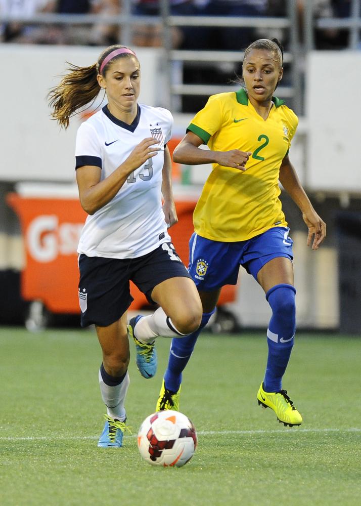 ORLANDO, FL - NOVEMBER 10: Forward Alex Morgan #13 of the U.S. Women's National Team controls the ball head of defender Rilan