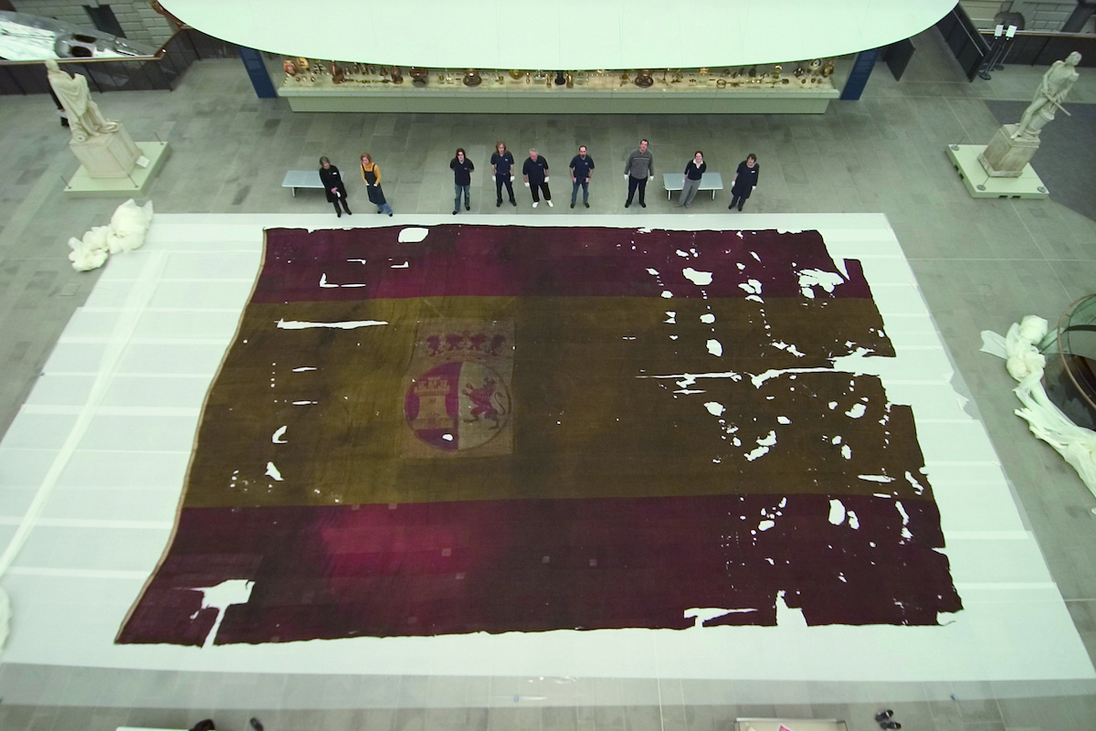 This is a Spanish ensign flag that flew from the back of a warship called the San Ildefonso during the Battle of Trafalgar. I