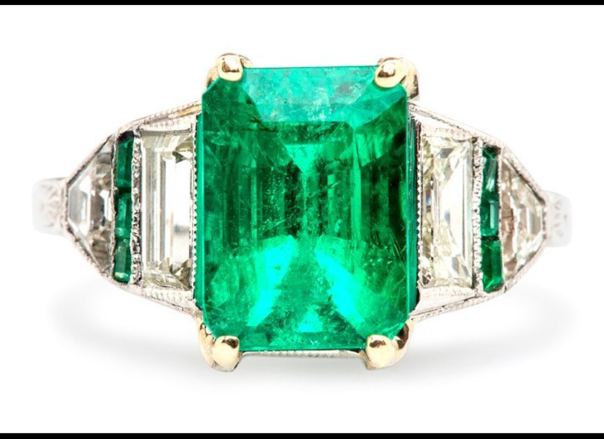 "Just like Halle Berry and Jackie O, Zoe Saldana joined the emerald ring club with a stunning <a href=""http://blog.theknot.com"