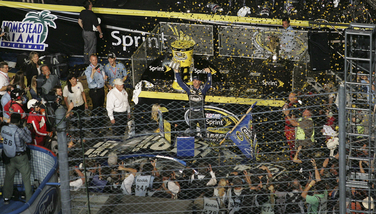 Jimmie Johnson, center, celebates after winning the NASCAR Sprint Cup Series Championship in Homestead, Fla., Sunday, Nov 17,