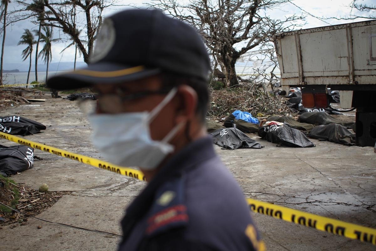 A policeman, near the City of Tacloban. His task is to help recover and identify bodies of Typhoon Yolanda victims. November