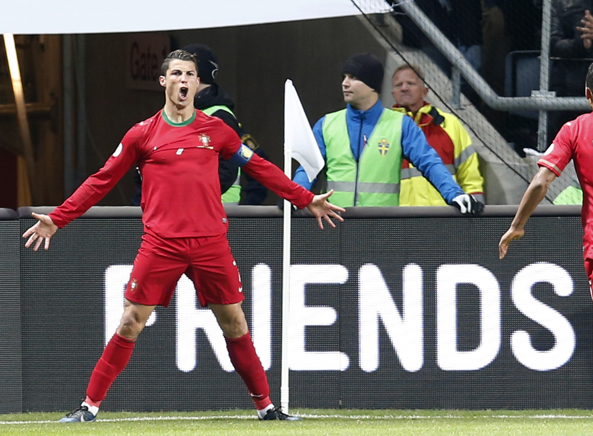 Portugal's Cristiano Ronaldo celebrates scoring the opening goal during the World Cup qualifying playoff second leg soccer ma