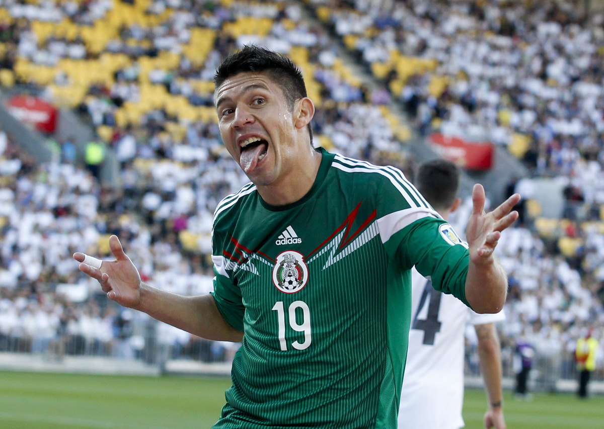 Mexico's Oribe Peralta celebrates a goal against New Zealand in their World Cup qualifying soccer match at Westpac Stadium in