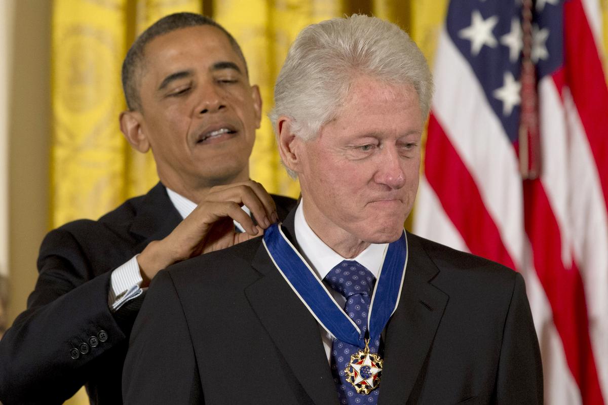 President Barack Obama awards former President Bill Clinton with the Presidential Medal of Freedom, Wednesday, Nov. 20, 2013,