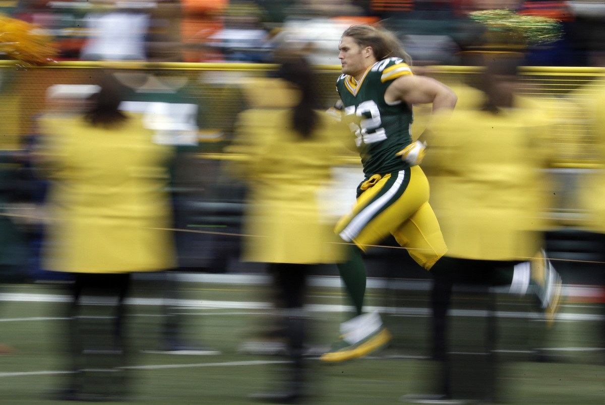 Green Bay Packers' Clay Matthews is introduced before the first half of an NFL football game against the Minnesota Vikings Su
