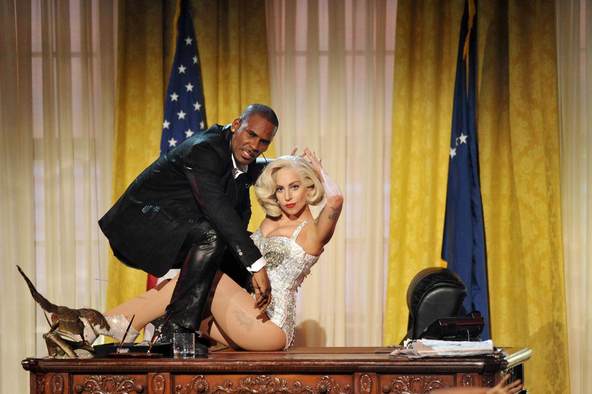 R. Kelly, left, and Lady Gaga perform at the American Music Awards at the Nokia Theatre L.A. Live on Sunday, Nov. 24, 2013, i