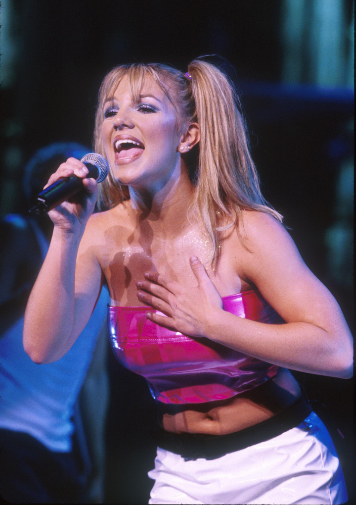 """Spears burst onto the scene at age 16 with the mega-hit """"...Baby One More Time."""" But she had actually been steadily performin"""
