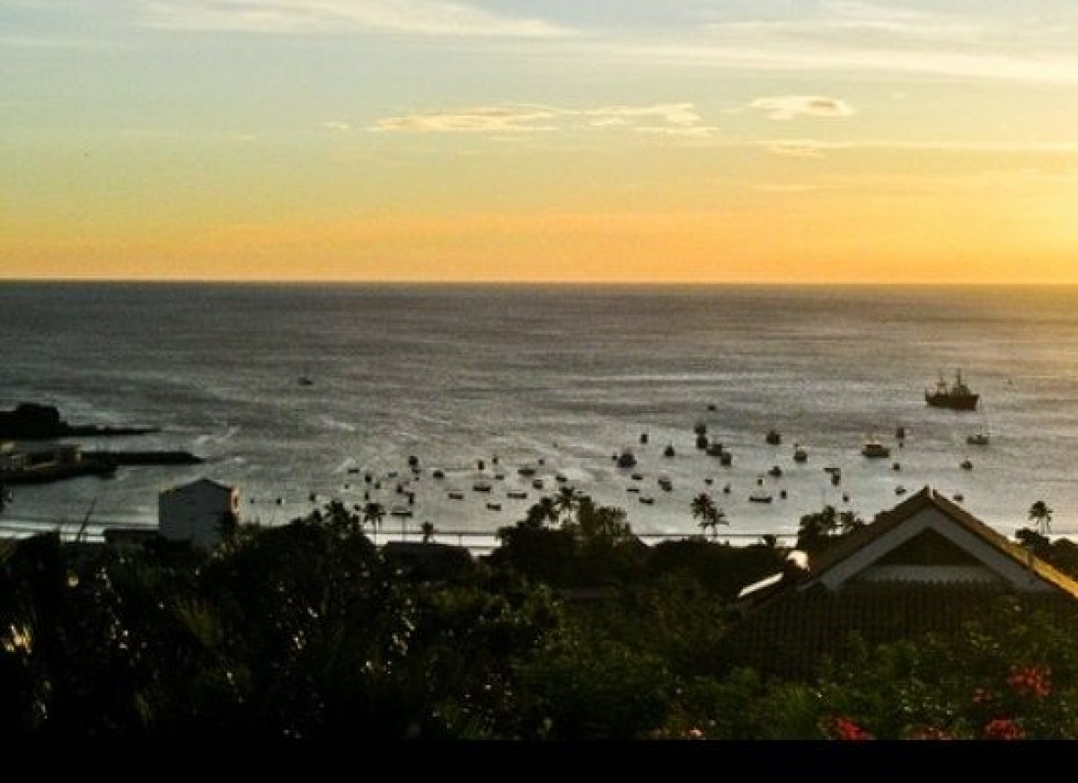 Sunset from the hills above the town. Visit the Pelican Eyes Resort (the best hotel in town) for happy hour to take in this v