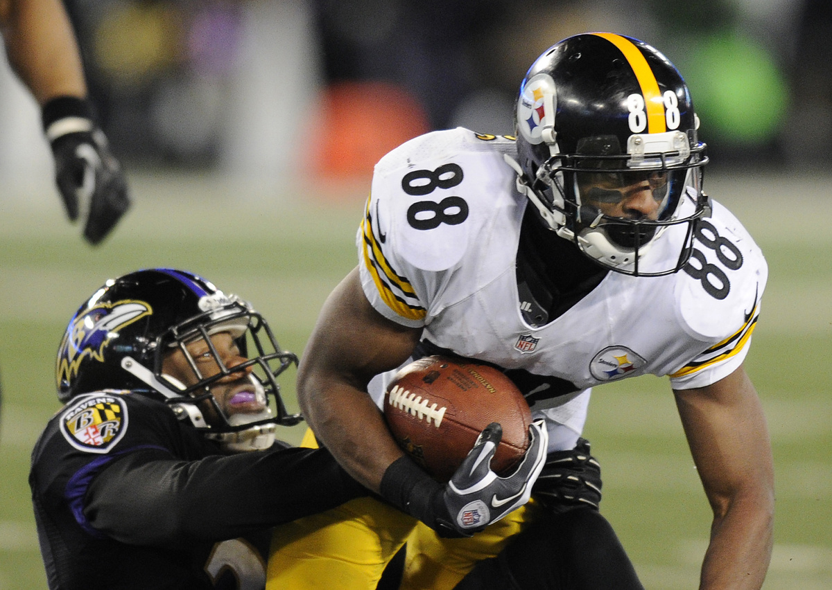 Pittsburgh Steelers wide receiver Emmanuel Sanders (88) is tackled by Baltimore Ravens cornerback Corey Graham in the second