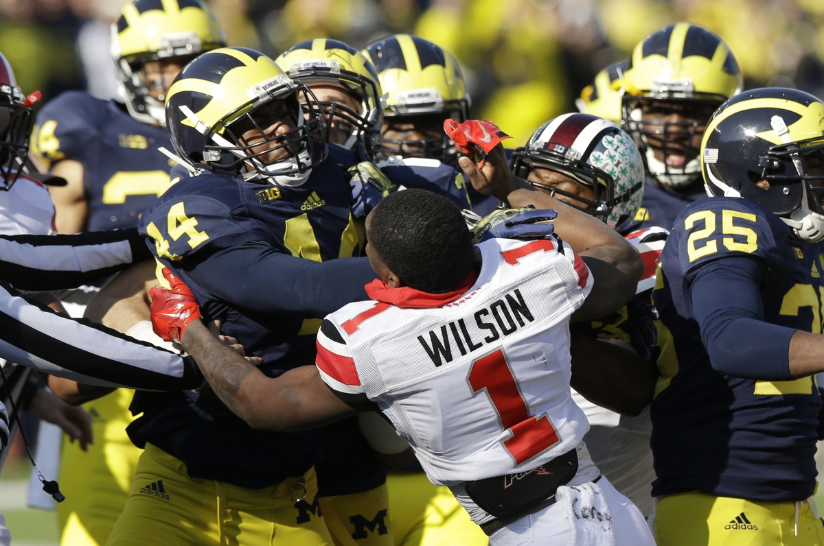 Ohio State's Dontre Wilson (1) is held back by Michigan defensive back Delano Hill (44) as the two teams scuffle during the s