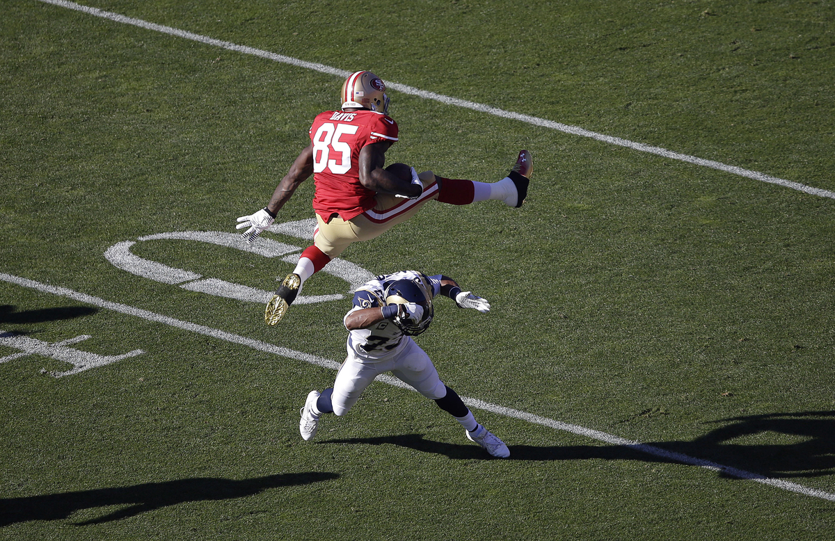San Francisco 49ers tight end Vernon Davis (85) jumps over St. Louis Rams free safety Rodney McLeod during the first quarter