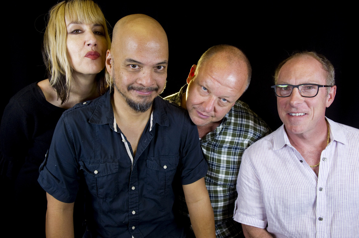 In this Friday, Sept. 20, 2013 photo, rock band The Pixies, from left, Kim Shattuck, Joey Santiago, Black Francis and David L