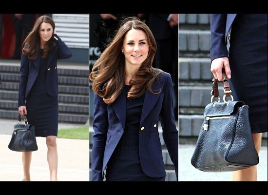 Jacket by Smythe, dress by Roland Mouret dress, pumps by Manolo Blahnik and leather bag by Mulberry. (Getty photos)