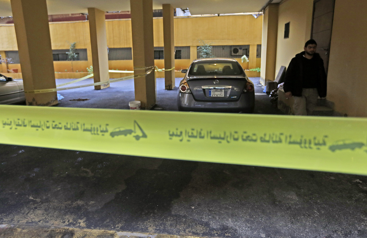 Yellow police tape seals off the scene where Hassan al-Laqis, a senior commander for the Lebanese militant group Hezbollah, w