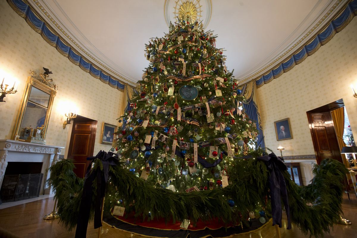 The ornament laden White House Christmas tree is seen in the Blue Room of the White House in Washington, Wednesday, Dec. 4, 2