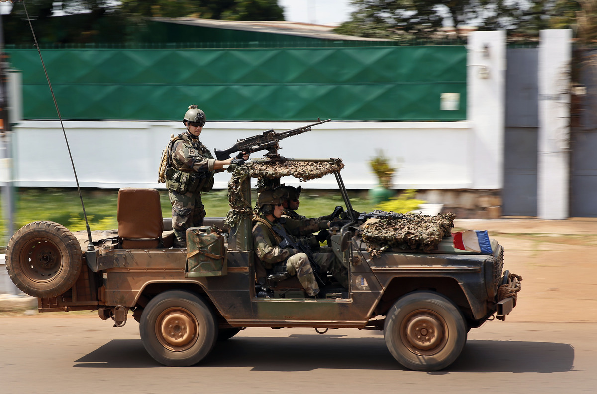 French Special Forces race through Bangui, Central African Republic, Thursday, Dec. 5, 2013 as gunfire and mortar rounds erup