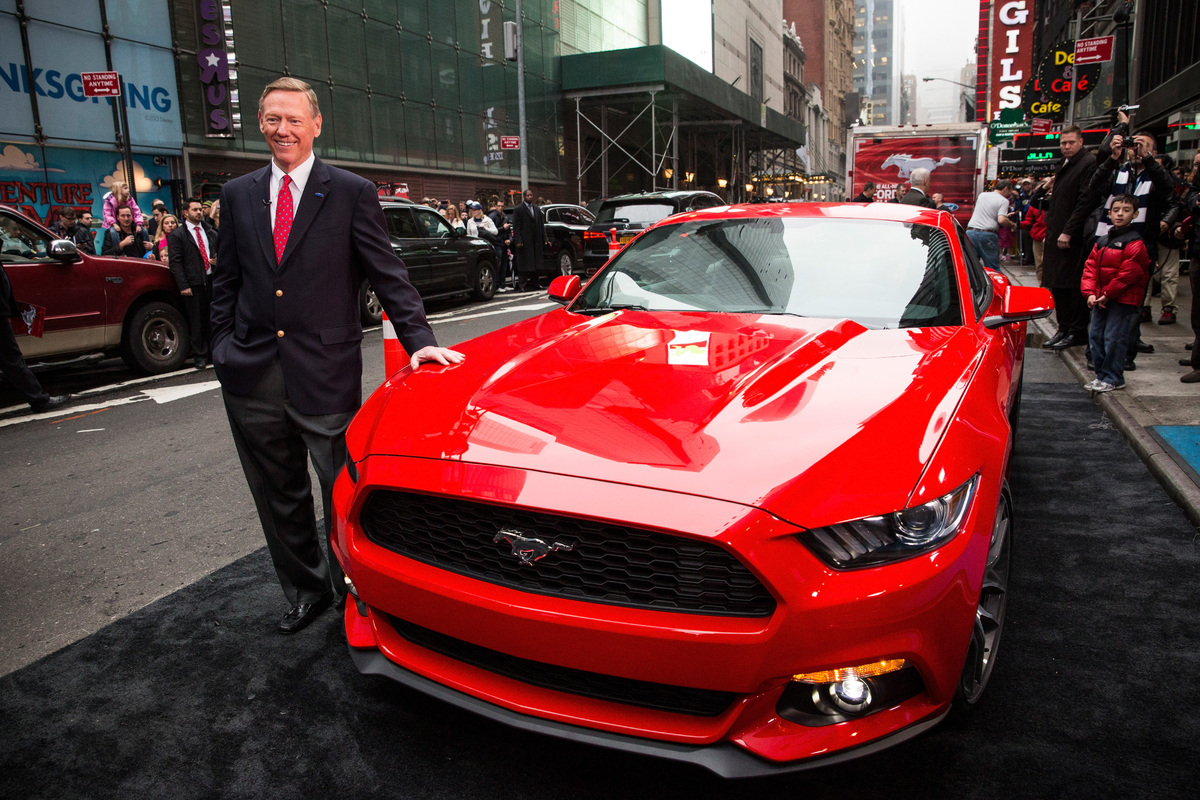 NEW YORK, NY - DECEMBER 05:  Alan Mulally, CEO of Ford, poses next to the 2015 Ford Mustang on the set of Good Morning Americ
