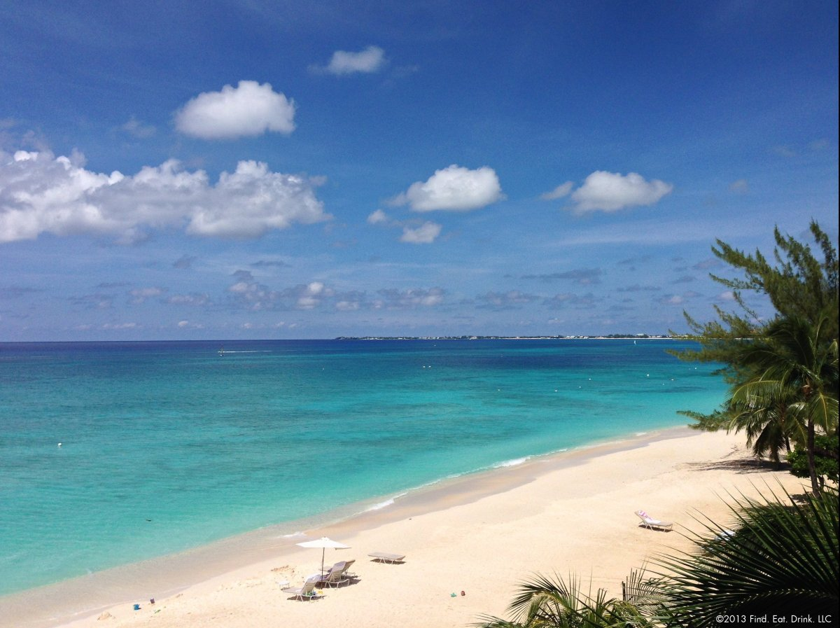 """Grand Cayman lures people with pristine aqua blue waters, white sandy beaches and coral reef diving.<br><br>Photo: <a href=""""h"""