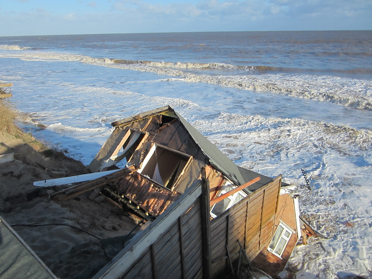 One of the five bungalows in Hemsby, Norfolk which fell into the sea last night as the tidal surge caused the cliff to break