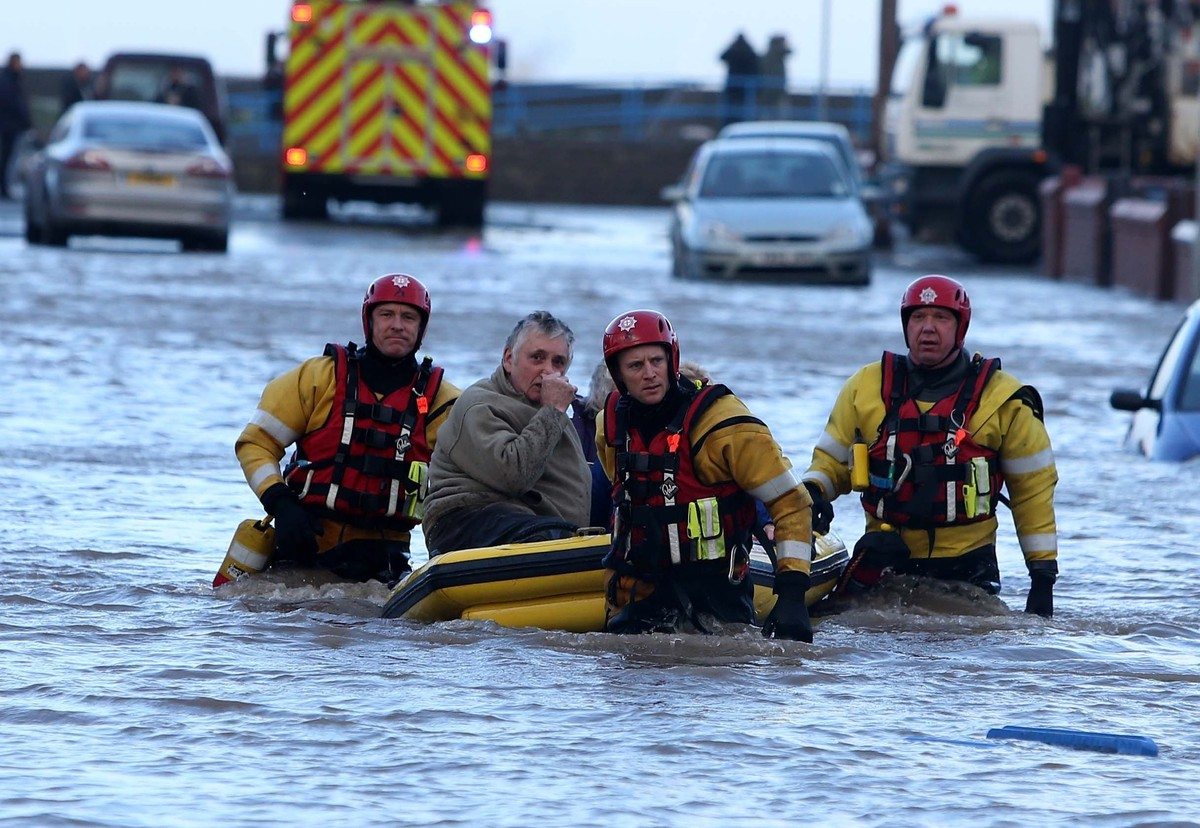 People are rescued by the RNLI from the floods in Rhyl as heavy seas and high tides sweep across the country.