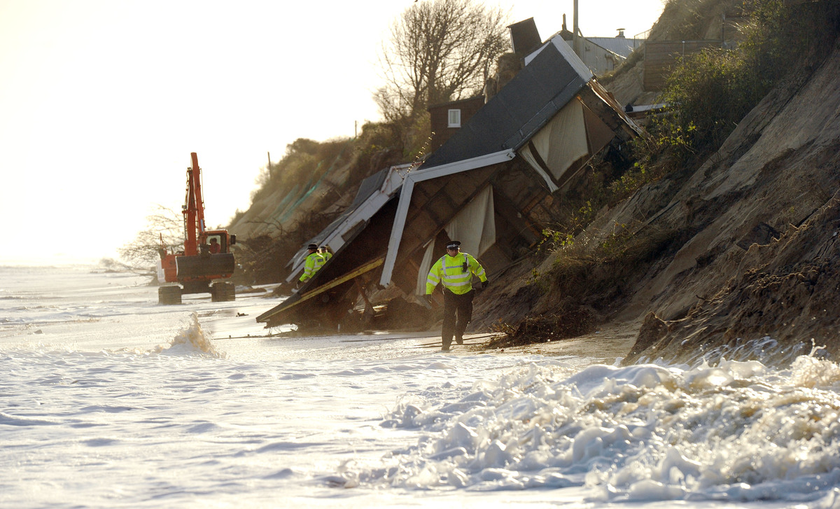 Houses collapse into the North Sea and some wash completely away as the cliffs collapse in the seaside village of Hemsby, Nor