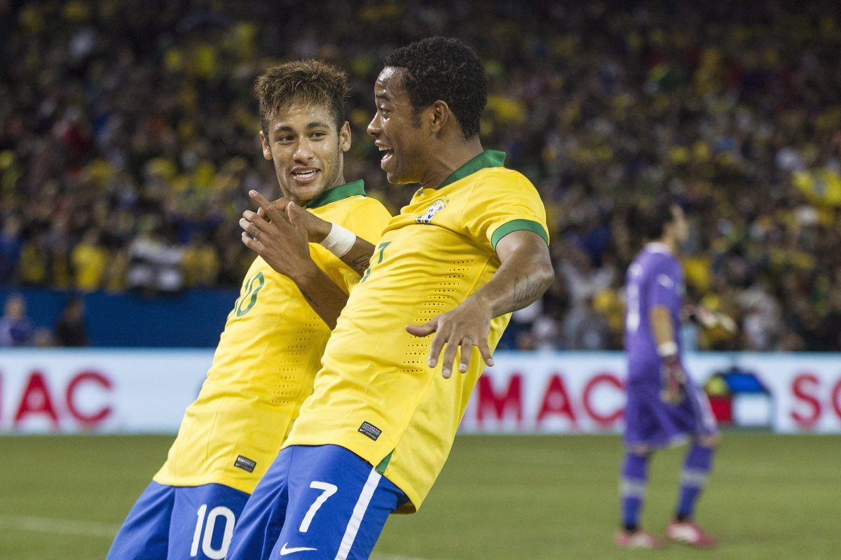 Brazil's Robinho, center, celebrates with Neymar after scoring the winning goal during the second half of their international