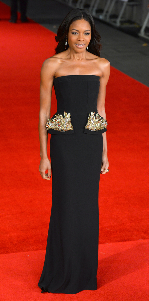 English actress Naomie Harris, who plays the role of Mandela's wife Winnie, poses on the red carpet upon arrival to attend th