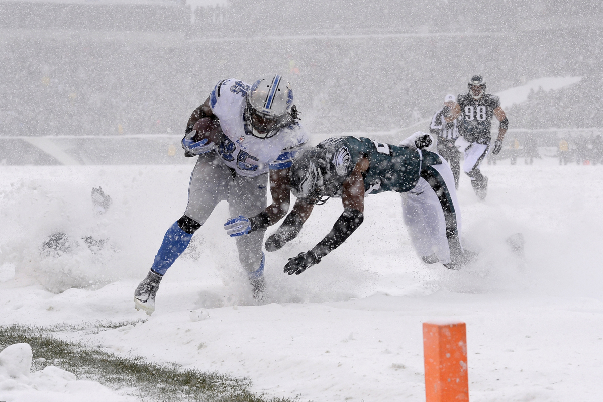 Detroit Lions' Joique Bell, left, is tackled by Philadelphia Eagles' Bradley Fletcher during the first half of an NFL footbal