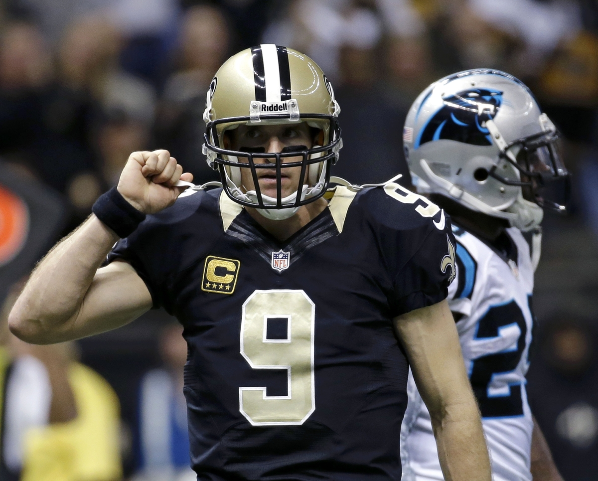 New Orleans Saints quarterback Drew Brees (9) reacts after a touchdown pass in the first half of an NFL football game against