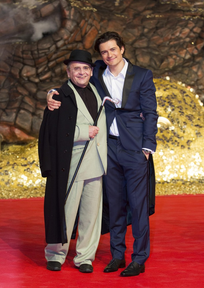 "British actors Orlando Bloom, right, and Sylvester McCoy arrive for the European Premiere of the movie ""The Hobbit: The Desol"
