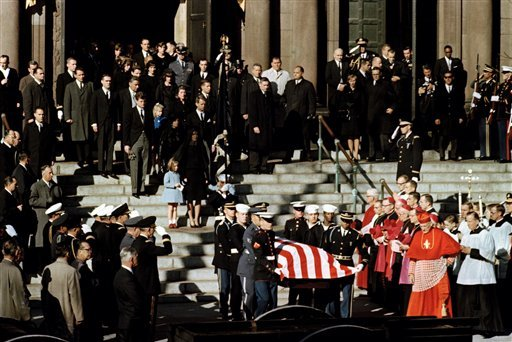 On the morning of Nov. 24, two days after 46-year-old President John F. Kennedy was killed, his flag-covered casket was carri