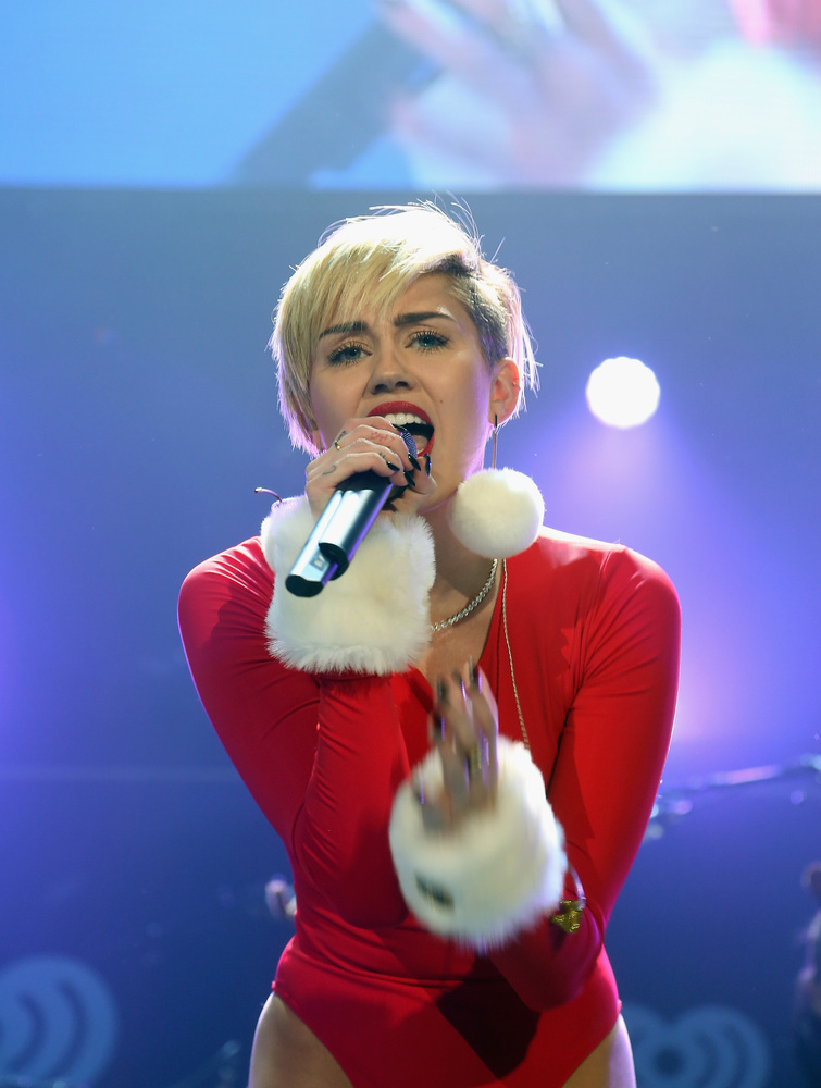 Miley Cyrus performs onstage during 101.3 KDWBs Jingle Ball 2013, at Xcel Energy Center on December 10, 2013 in St. Paul, Mi