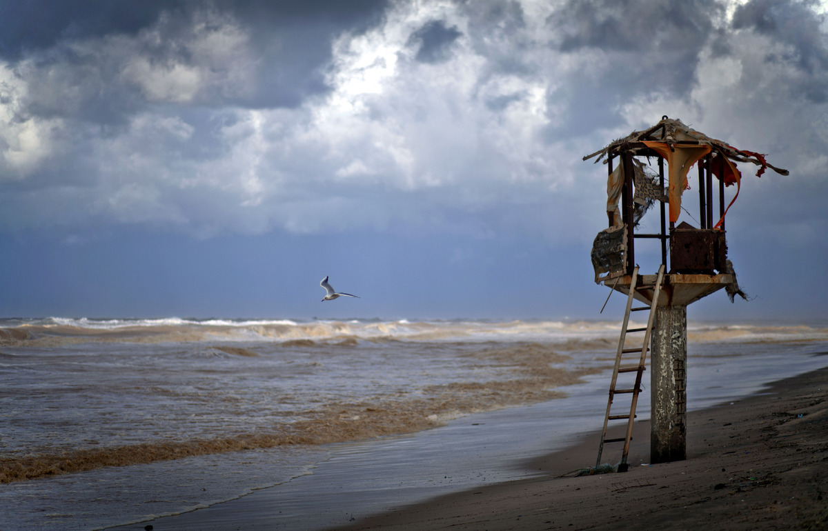 Dark clouds loom over the coast of the Mediterranean Sea in Gaza City, Friday, Dec. 13, 2013. Early snow has surprised many I