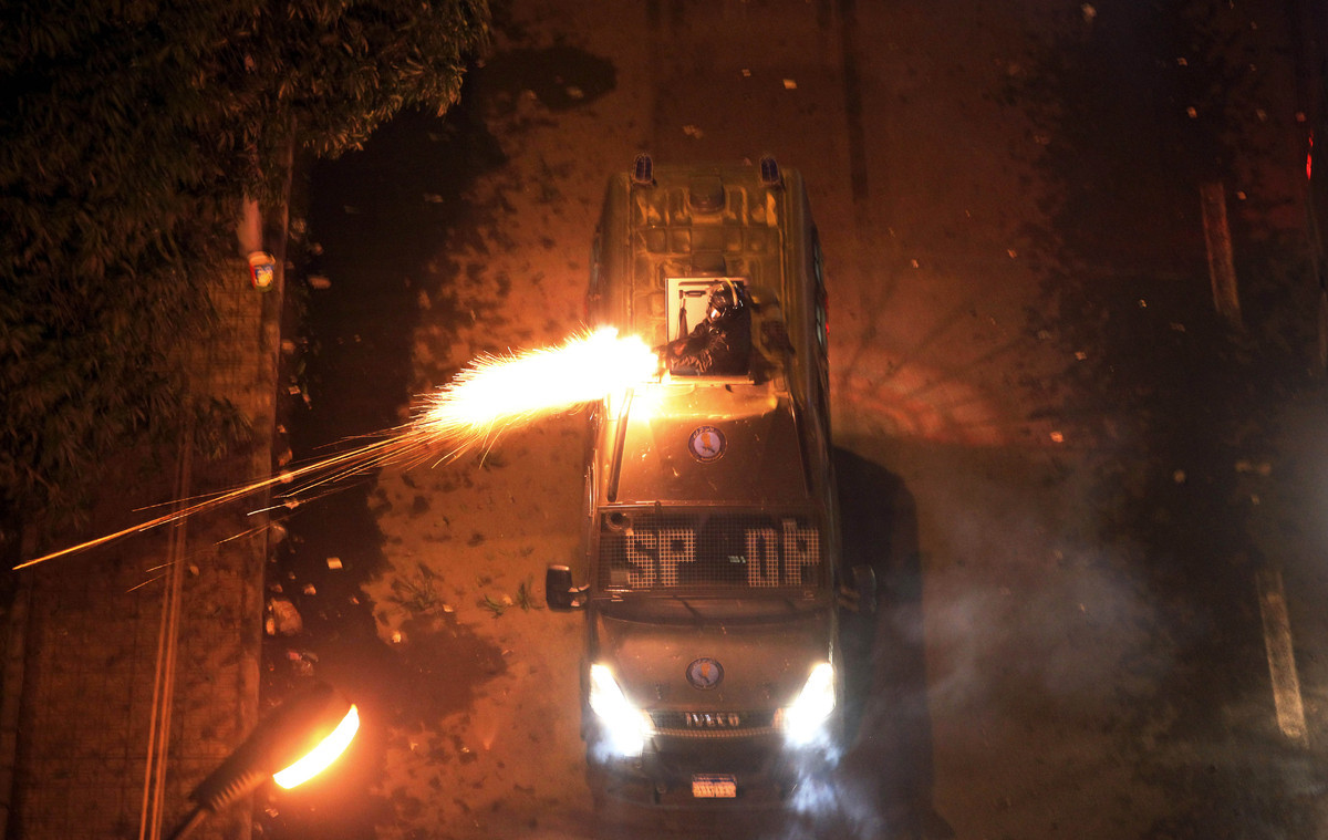 Egyptian riot police fire tear gas at protesters demonstrating in front of the presidential palace in Cairo, Egypt, Friday, F