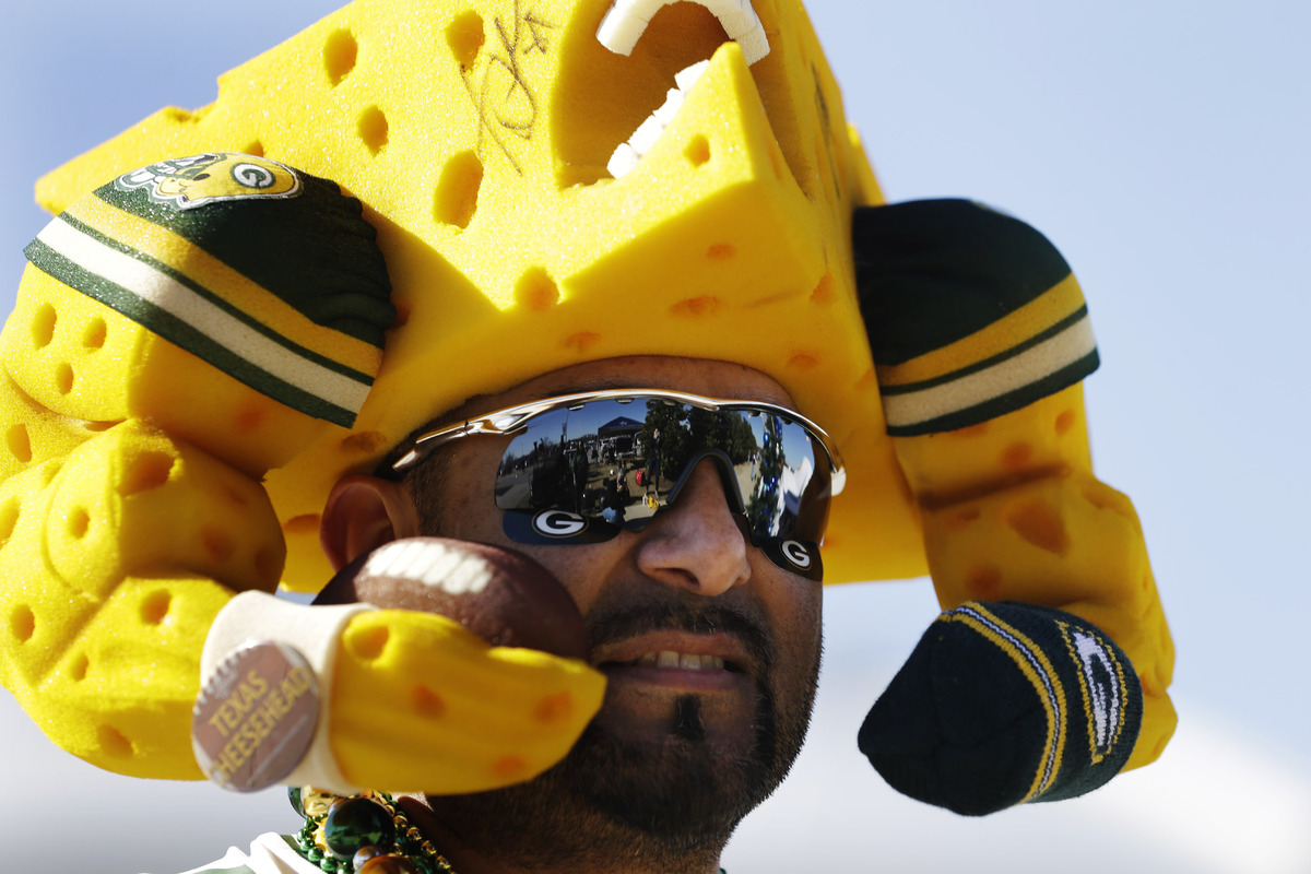 Green Bay Packers fan Richard Llanes shows support for his team before an NFL football game against the Dallas Cowboys, Sunda
