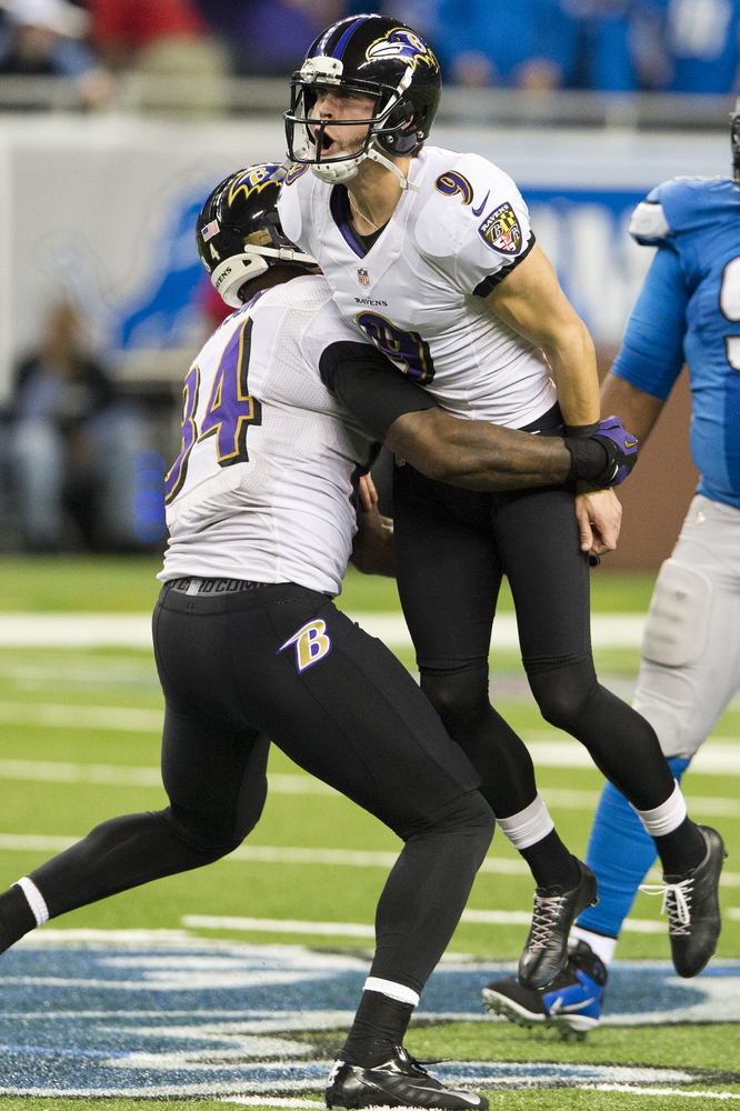 DETROIT, MI - DECEMBER 16: Tight end Ed Dickson #84 of the Baltimore Ravens celebrates with kicker Justin Tucker #9 of the Ba