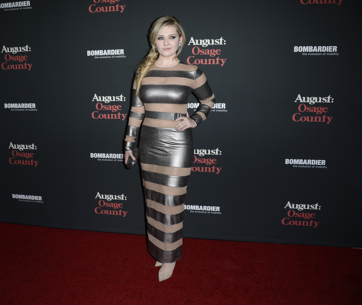 """Actress Abigail Breslin arrives at the premiere of the feature film """"August: Osage County"""" at Regal Cinemas L.A. Live on Mond"""