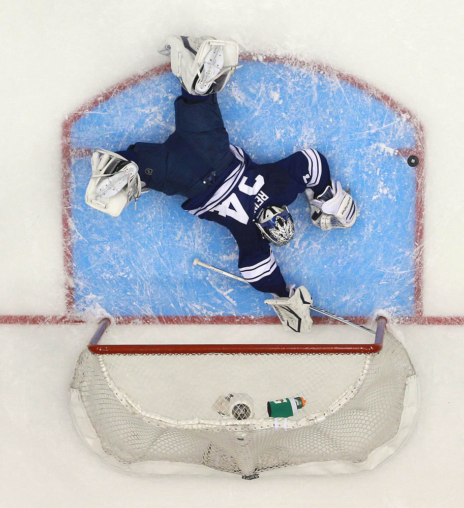 James Reimer makes a stop  as the Toronto Maple Leafs lose in overtime to the Boston Bruins to fall behind 3-1in their first