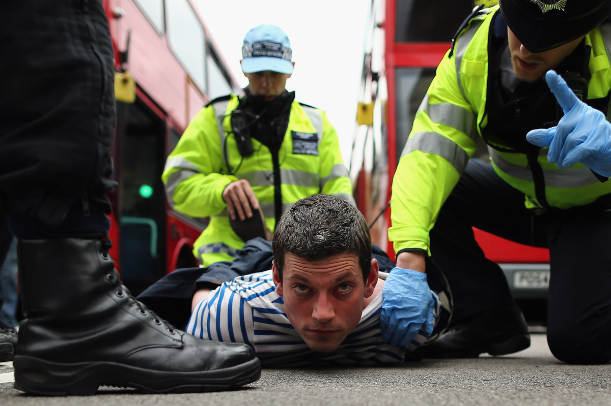 A protester is arrested after skirmishes with police on June 1, 2013 in London, England. Dozens of police officers attended a