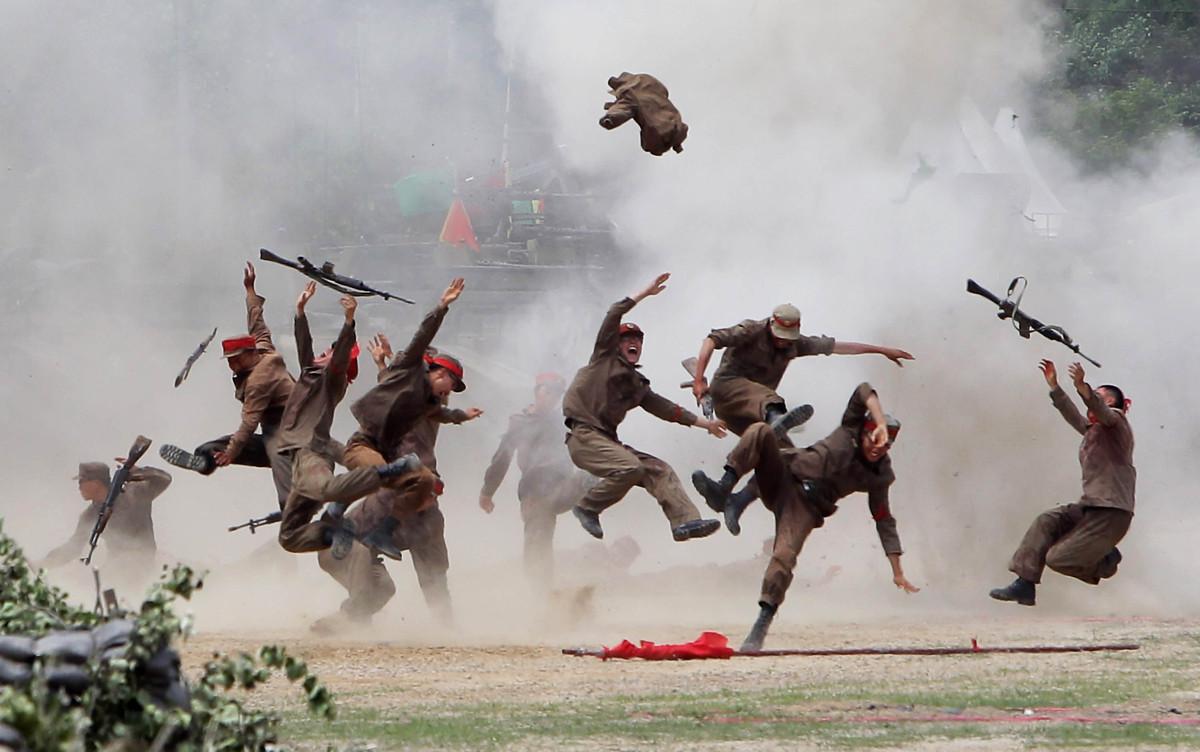 South Korean soldiers wear North Korea's military uniforms, acting as North Korean soldiers, as they take part in a re-enactm