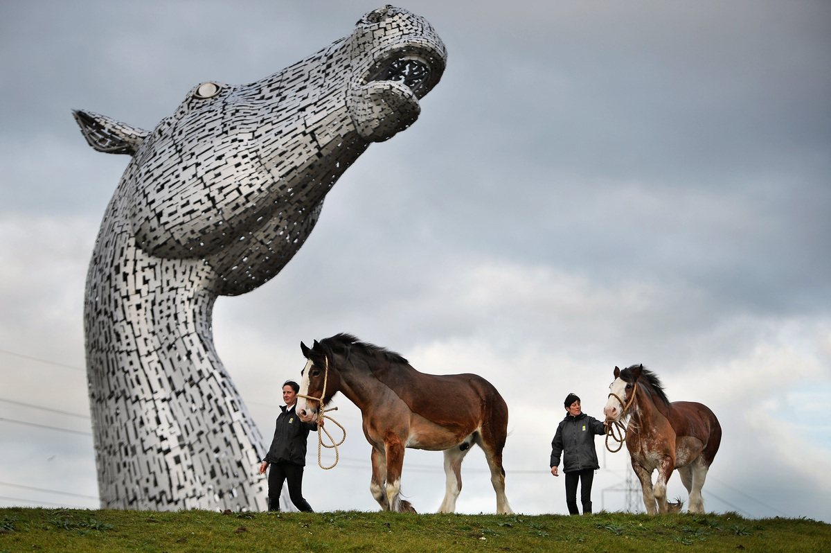 Donna Auchinvole with Duke and Lorraine Clark with Barron, Clydesdale Horses, attend a topping out ceremony at The Kelpies on