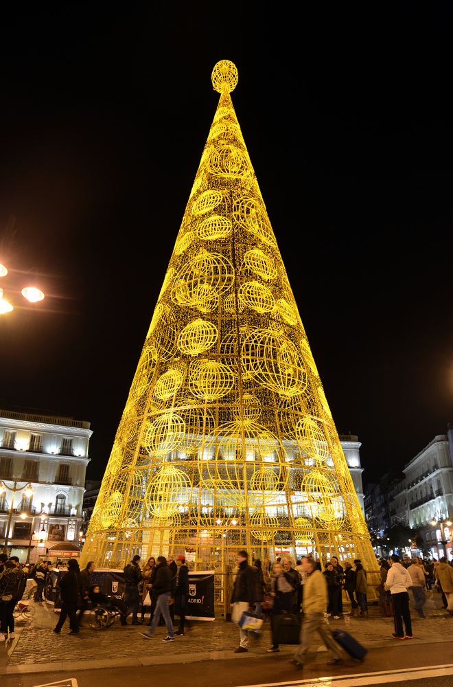 A giant Christmas tree illuminates the Puerta del Sol in the centre of Madrid on December 9, 2013.  AFP PHOTO/ GERARD JULIEN