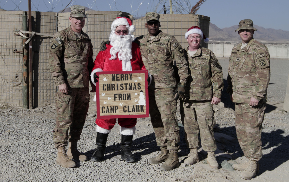 U.S. Maj. Gen. James C. McConville, left, poses with soldiers at Camp Clark during a Christmas visit in Khost province, easte