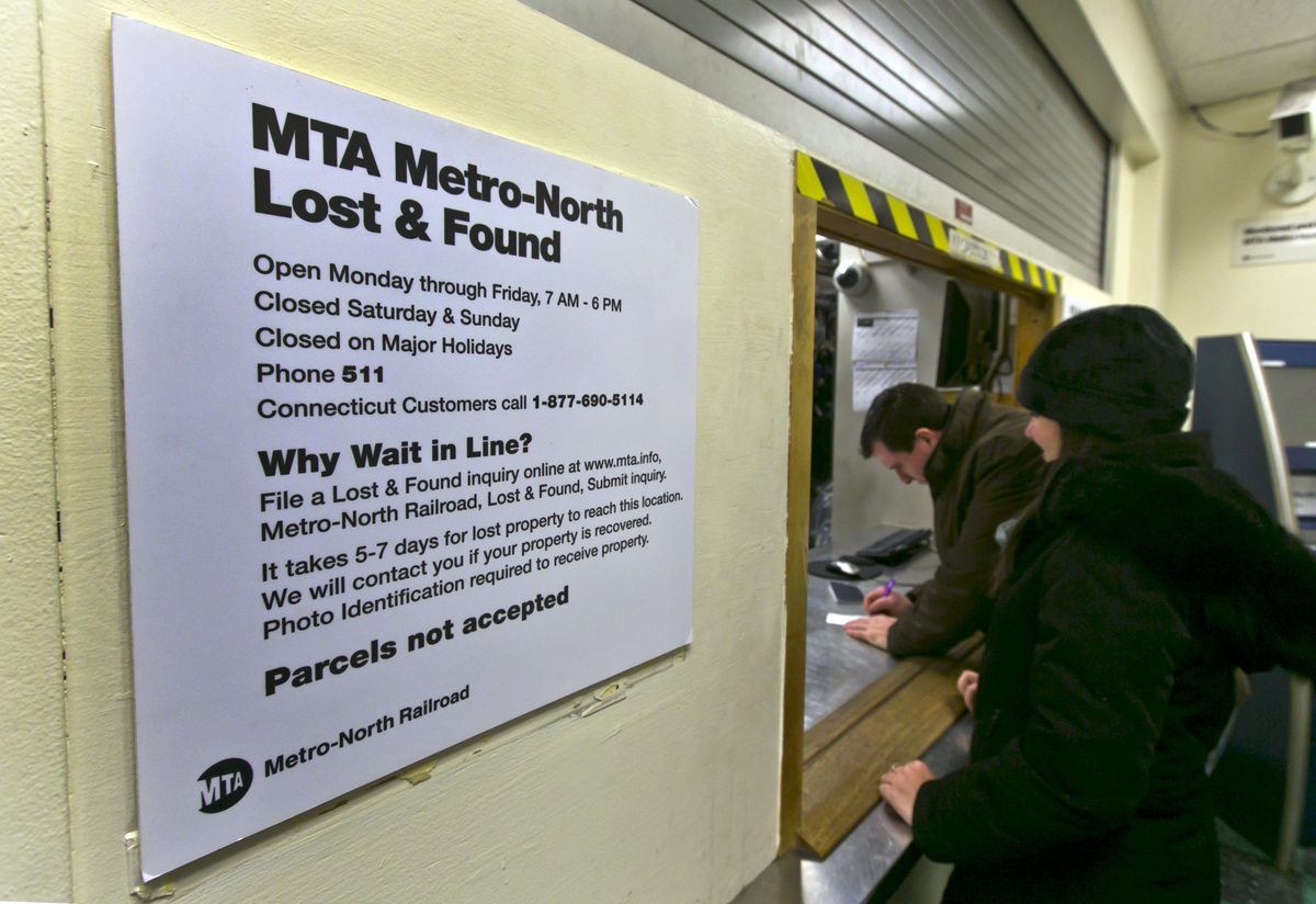 In this Tuesday, Dec. 17, 2013 photo, a couple retrieves a lost item at the window of the MTA Metro-North Lost and Found depa