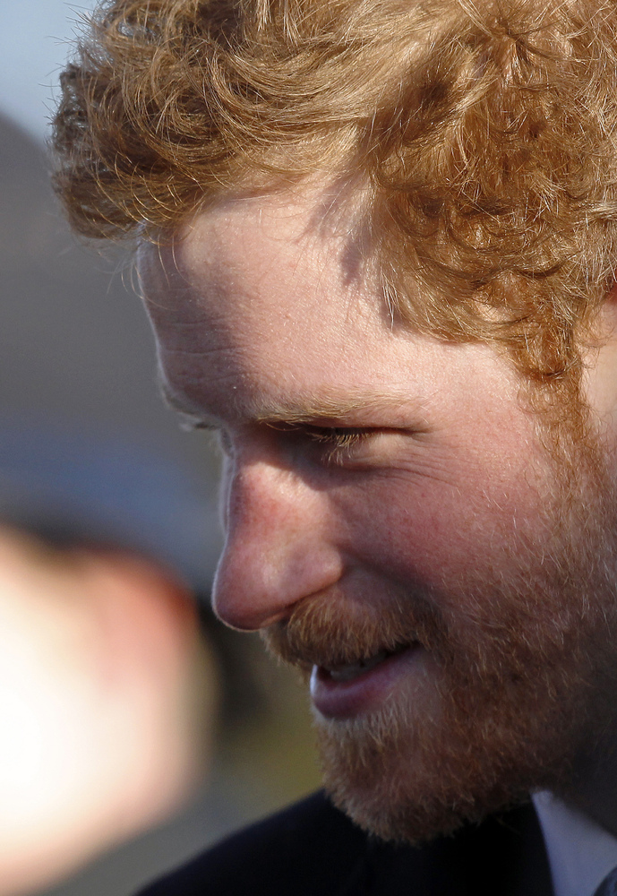 Britain's Prince Harry arrives for a traditional Christmas Day Church Service at Sandringham in eastern England, on December