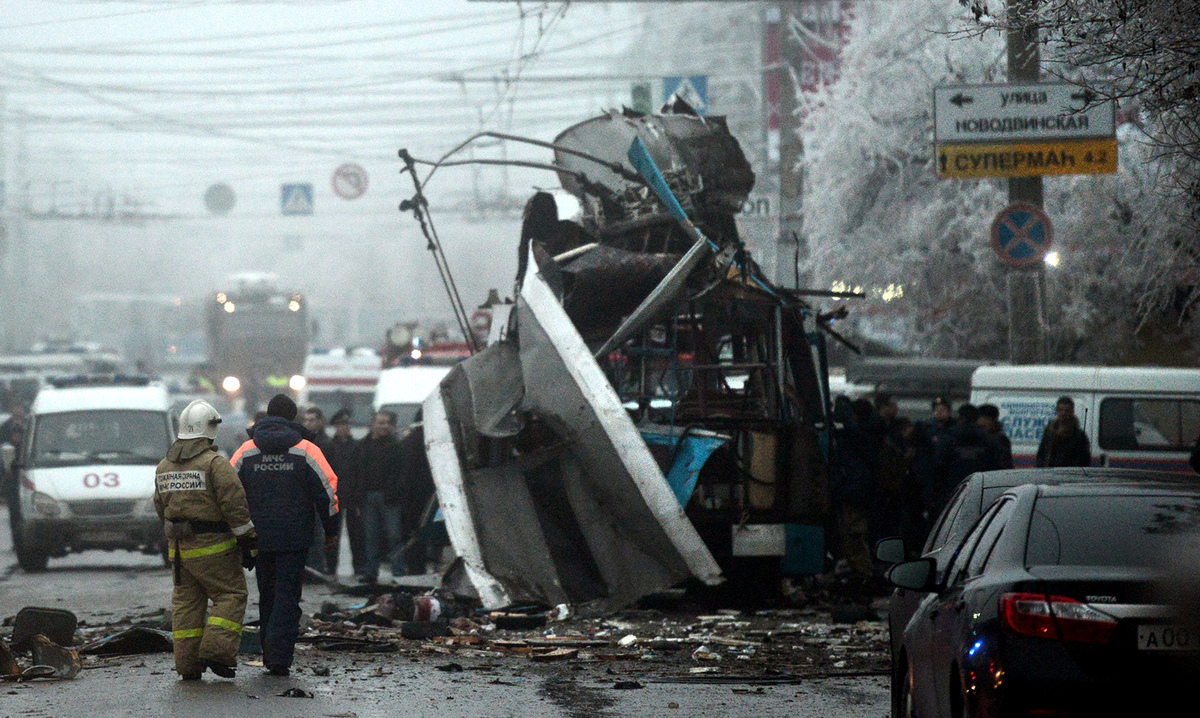 Russian firefighters and security personnel inspect the destroyed trolleybus in Volgograd on December 30, 2013. (STRINGER/AFP