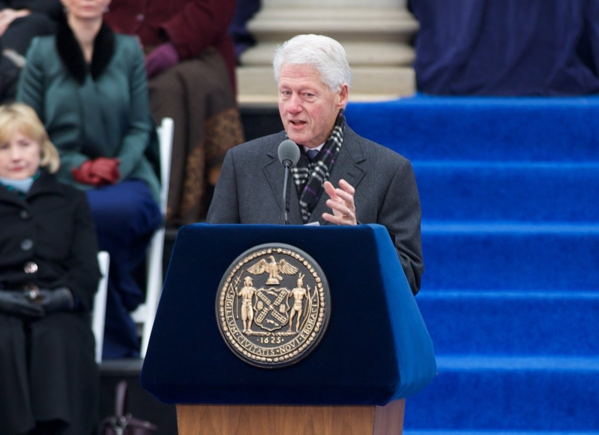 Bill Clinton introduces Bill De Blasio,  as Secretary Hillary Clinton looks on.