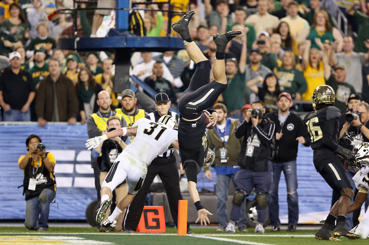 GLENDALE, AZ - JANUARY 01:  Bryce Petty #14 of the Baylor Bears flips into the endzone to score a second quarter touchdown ag