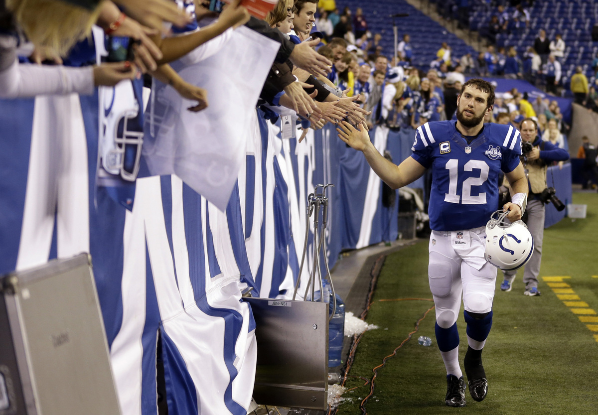 Indianapolis Colts' Andrew Luck (12) greets fans as he leaves the field following an NFL football game against the Jacksonvil
